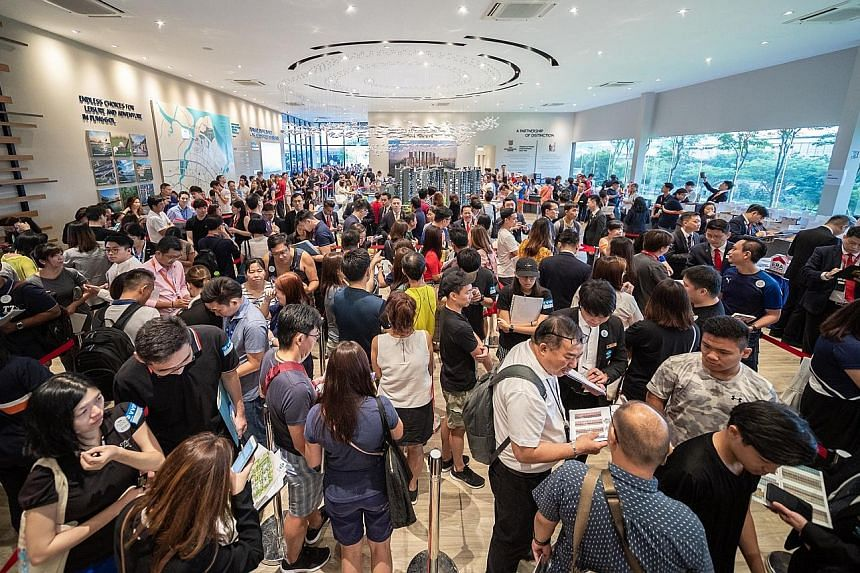 Visitors at the sales gallery for Piermont Grand, an executive condominium developed by City Developments, last month. In the quarter ended June 30, the group recognised progressive contributions from two projects - The Tapestry and Whistler Grand -
