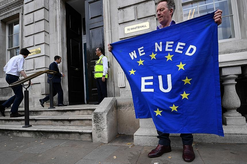A pro-EU campaigner outside the Cabinet Office in London on Wednesday. British Prime Minister Boris Johnson has vowed to take Britain out of the EU by the deadline, even if it means doing so without an agreement.