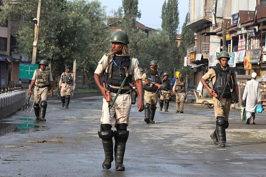Indian paramilitary soldiers on patrol in Srinagar on Wednesday. An unprecedented security lockdown amid a near-total communications blackout entered a fourth day yesterday, following the decision by New Delhi to revoke the special status of Jammu an