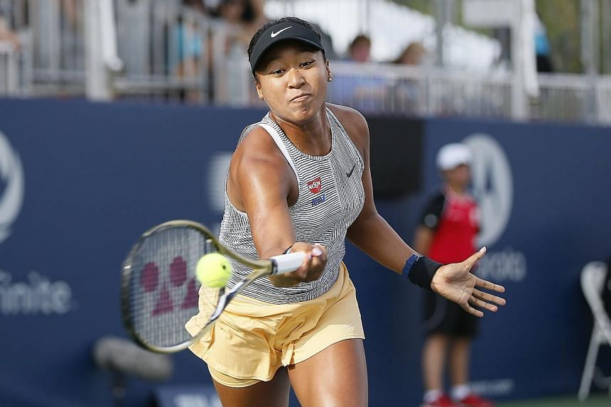 Naomi Osaka of Japan hitting a return to Tatjana Maria during their Rogers Cup match in Toronto on Wednesday. The German retired with an injury in the second set. PHOTO: REUTERS