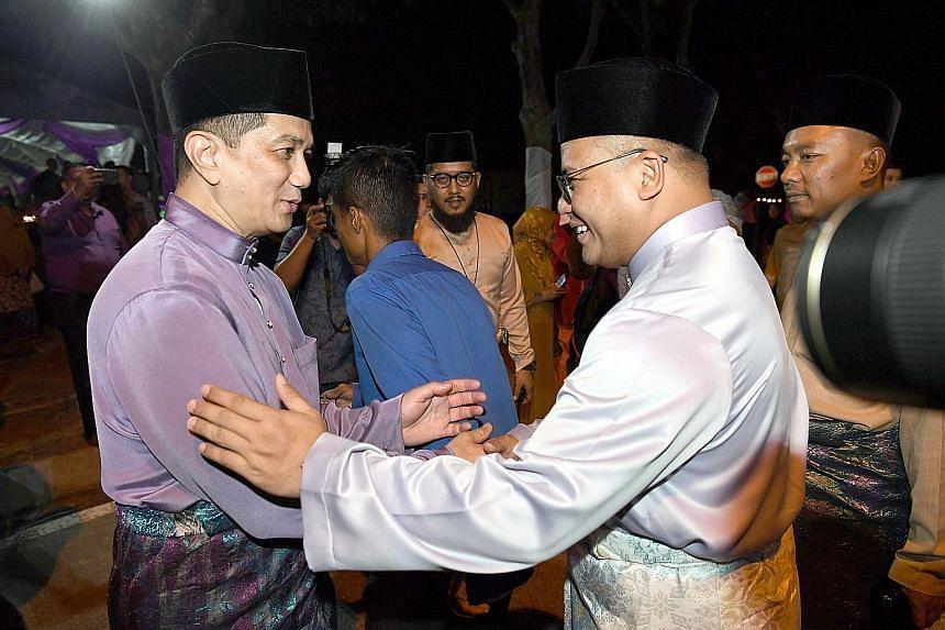 In this file photo of a Hari Raya event on June 30, Economic Affairs Minister Azmin Ali (left) and Selangor Menteri Besar Amirudin Shari are seen exchanging greetings. PHOTO: BERNAMA