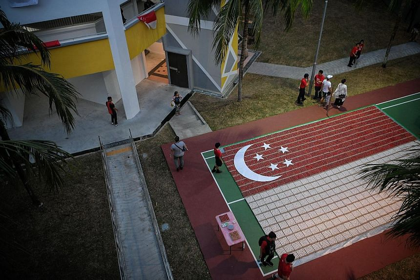 A display of the nation's flag created from 18,000 eggs near Block 686 Hougang Street 61 yesterday, at a Sengkang South community celebration that was attended by Prime Minister Lee Hsien Loong. ST PHOTO: MARK CHEONG