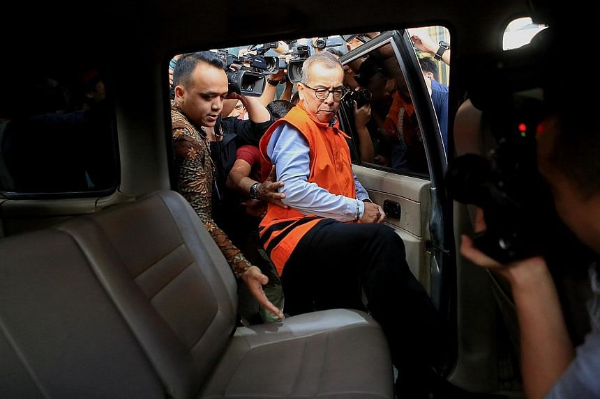 Former Garuda airline chief Emirsyah Satar being taken away after being questioned at the Corruption Eradication Commission on Wednesday in Jakarta. He has been arrested and detained over money-laundering and bribery allegations. PHOTO: THE JAKARTA P