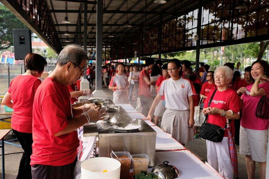 Residents queueing up for tutu kueh at one of the food stalls at the Moulmein-Cairnhill National Day observance ceremony on Aug 9, 2019.