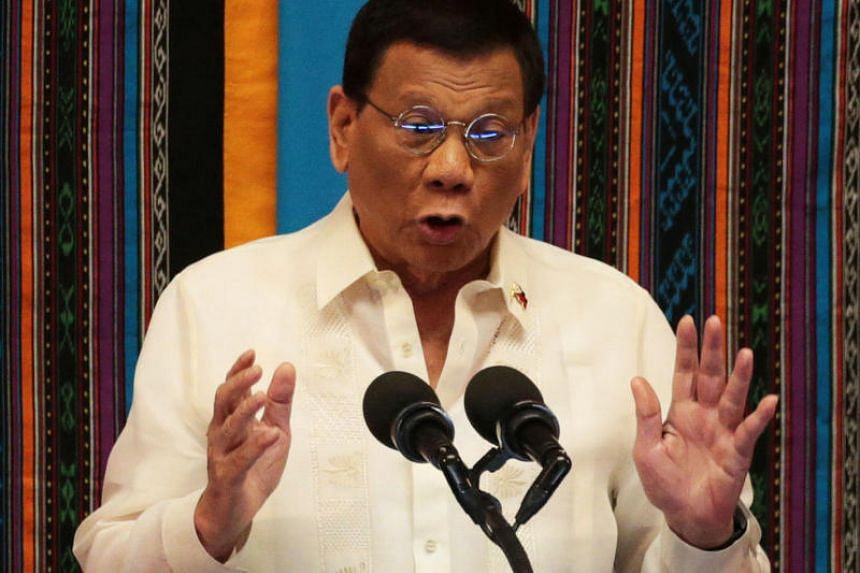 In this photo taken on July 22, 2019, Philippine President Rodrigo Duterte speaks at his State of the Nation Address in Quezon City Philippines. He is looking increasingly awkward in defending his controversial approach to China.