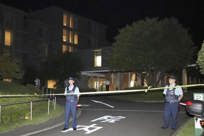 Policemen stand guard in front of a hospital where a man stabbed three nurses and a policeman in Shikokuchuo, Ehime Prefecture, on Aug 9, 2019.