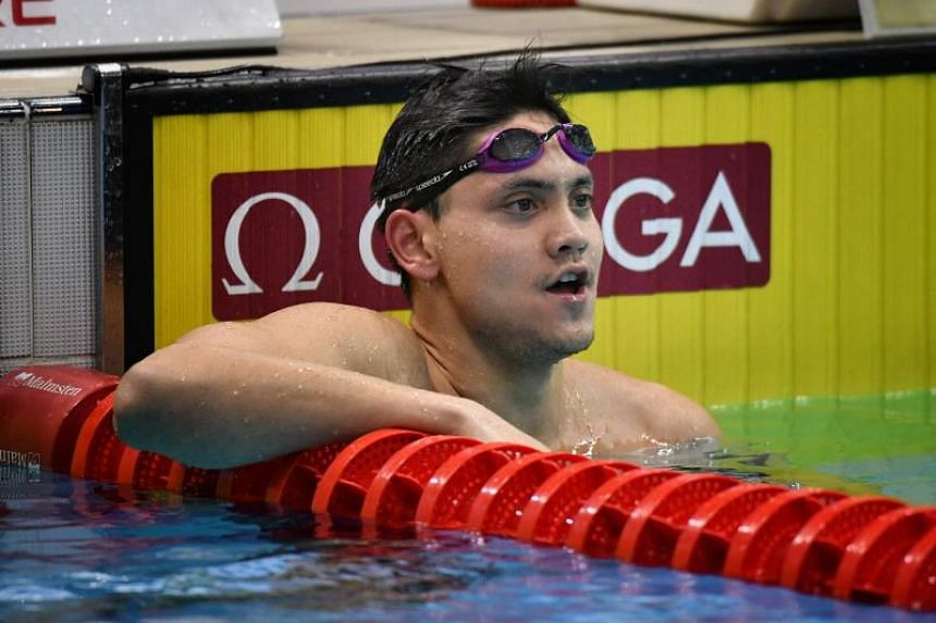 Joseph Schooling checking results after racing in the Men's 200m freestyle at the Singapore National Swimming Championships, on June 20, 2019.