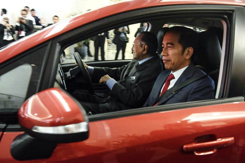 Indonesian President Joko Widodo (right) was personally driven by Prime Minister Mahathir Mohamad during his visit to Malaysia.