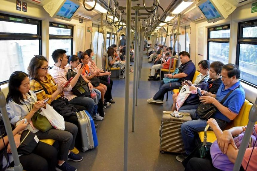 Commuters using their phones on a train in Bangkok. Thailand's General Apirat Kongsompong said the army was now fighting the challenge of propaganda on the Internet.