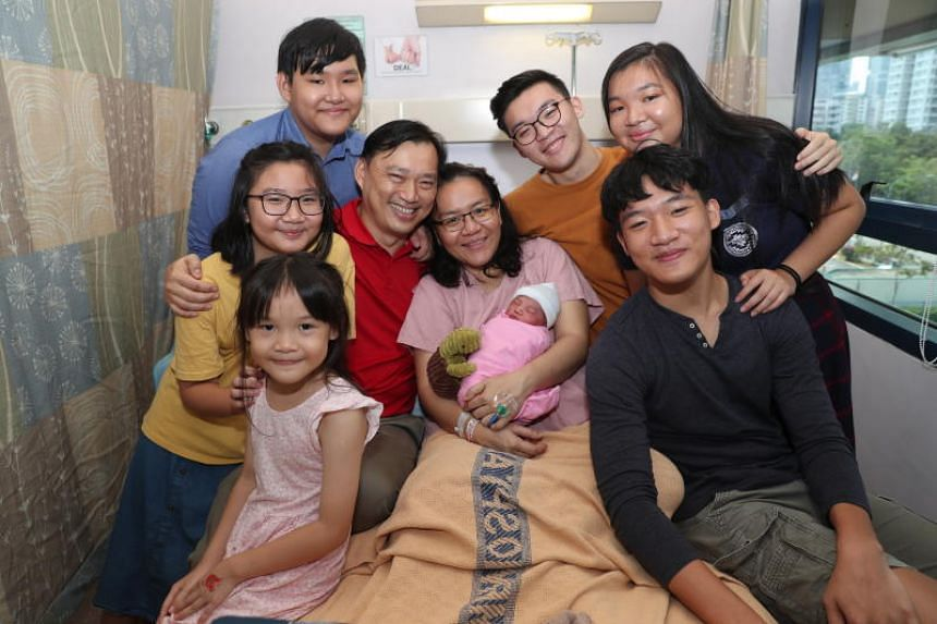 Mr Dan Ong and his wife Sue with their seven children including newborn Megan.