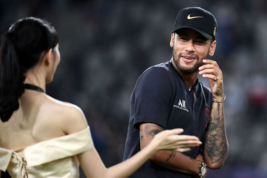 Neymar arrives on the podium at the end of the French Trophy of Champions match between Paris Saint-Germain and Rennes in Shenzhen on Aug 3, 2019.