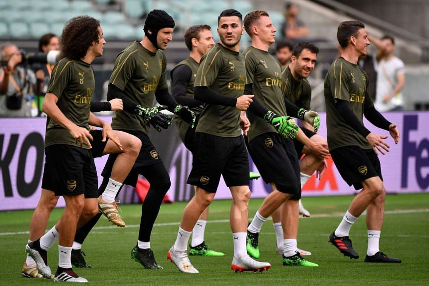 Arsenal players attend a training session in May 2019.