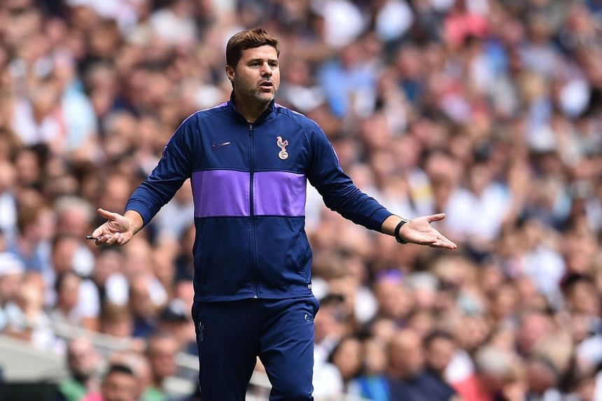 Pochettino gestures on the touchline during a match.
