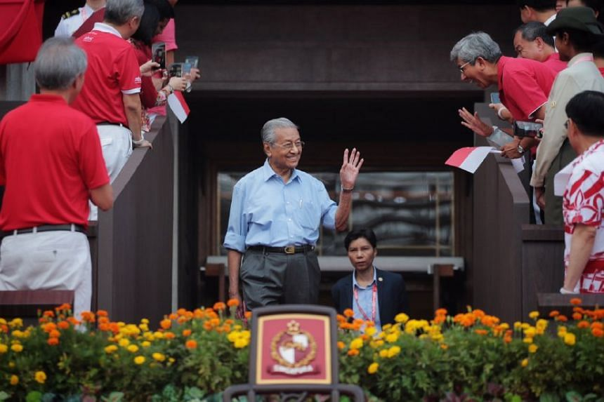 Malaysian Prime Minister Mahathir Mohamad arrives at the National Day Parade at the Padang on Aug 9, 2019.