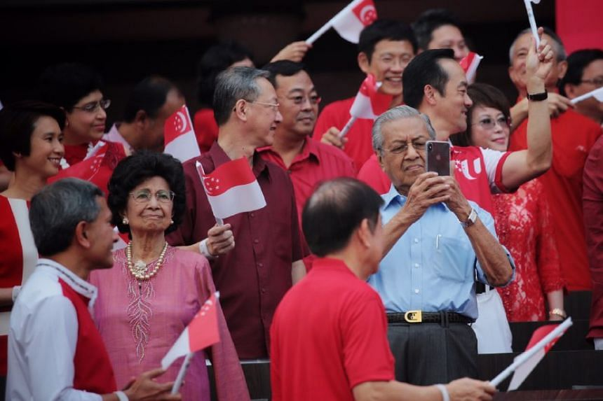 Malaysian Prime Minister Mahathir Mohamad and his wife, Tun Dr Siti Hasmah Mohamad Ali, at the National Day Parade at the Padang on Aug 9, 2019.