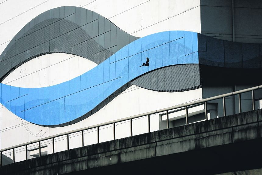 The silhouette of a bird juxtaposed against the wave-like design on the exterior of White Sands mall.