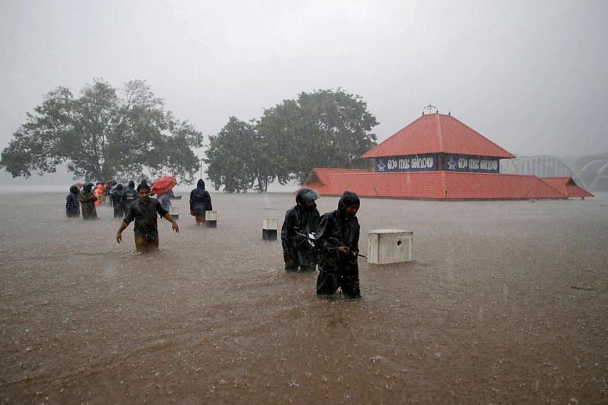 Indian media reported that at least two people were killed in a resulting landslide, at least 70 houses were destroyed and that dozens more were still feared trapped.