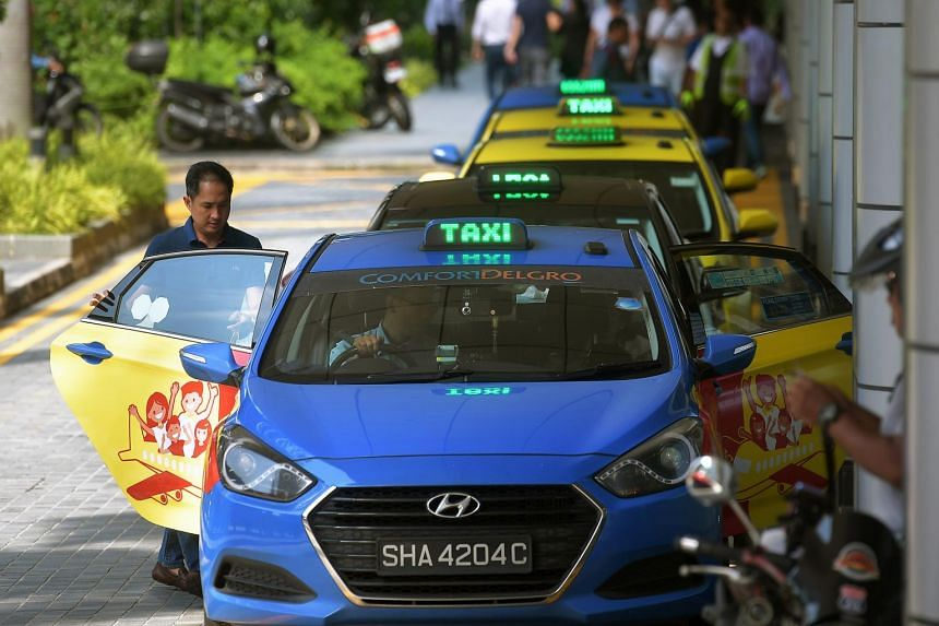 Taxis in line at a taxi stand in Singapore on May 15, 2019.