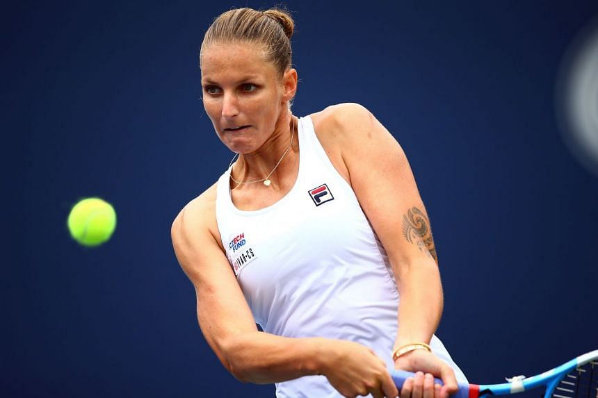 Karolina Pliskova hits a shot against Anett Kontaveit of Estonia.