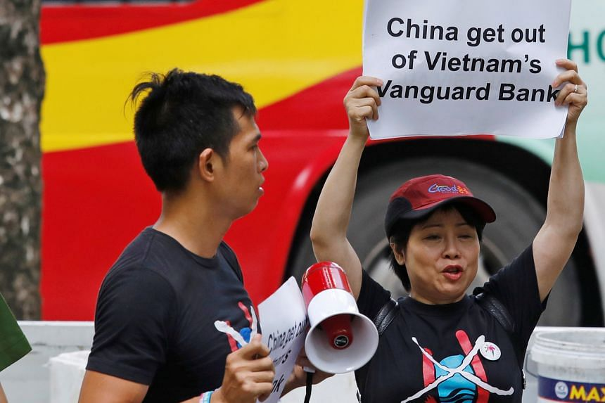 Protesters in Hanoi rallying against China's presence in the Vanguard Bank area of the South China Sea on Tuesday. Vietnam said China's Haiyang Dizhi 8 vessel has left its continental shelf.