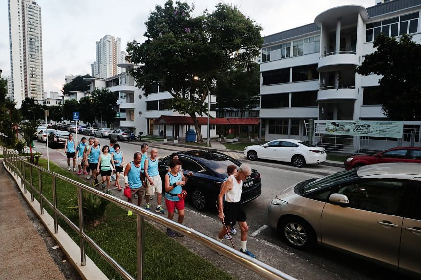 Above: Mr Tan with members of the jogging club on their route which features the iconic curved stair towers that make the area uniquely Tiong Bahru.