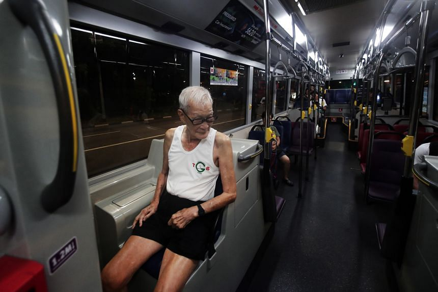 Above: Because of injuries Mr Tan sustained to both knees, he occasionally takes a bus to the end point of the route while waiting for the other joggers.