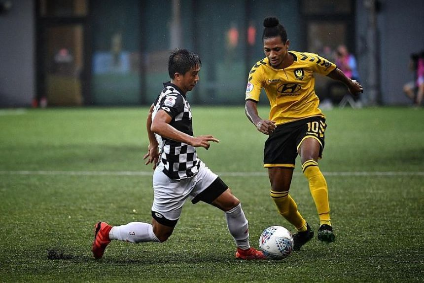 Tampines Rovers' Jordan Webb being challenged Brunei DPMM's Abdul Mu'iz Sisa when they met during a Singapore Premier League match on June 22, 2019.