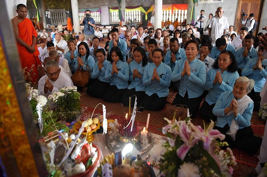 Relatives of former Khmer Rouge leader Nuon Chea praying during his funeral procession in Pailin, Cambodia, yesterday.