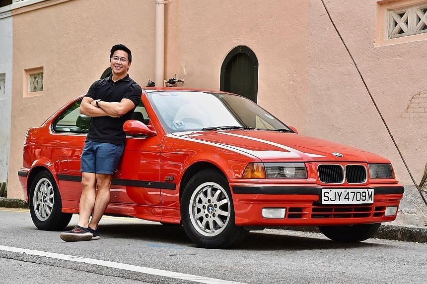 Mr Joseph Goh and his 22-year-old BMW 316i Compact, which he says he enjoys driving more than his parents' two BMWs at home. He estimates he may have spent about $20,000 over the past eight years to keep it running well.