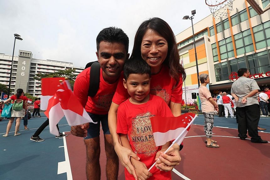 New Singapore citizen Chavda Ankur A, 32, with his Singaporean wife Leong Yi Peng, 38, and son Chavda Keval Ankur, five. ST PHOTO: TIMOTHY DAVID