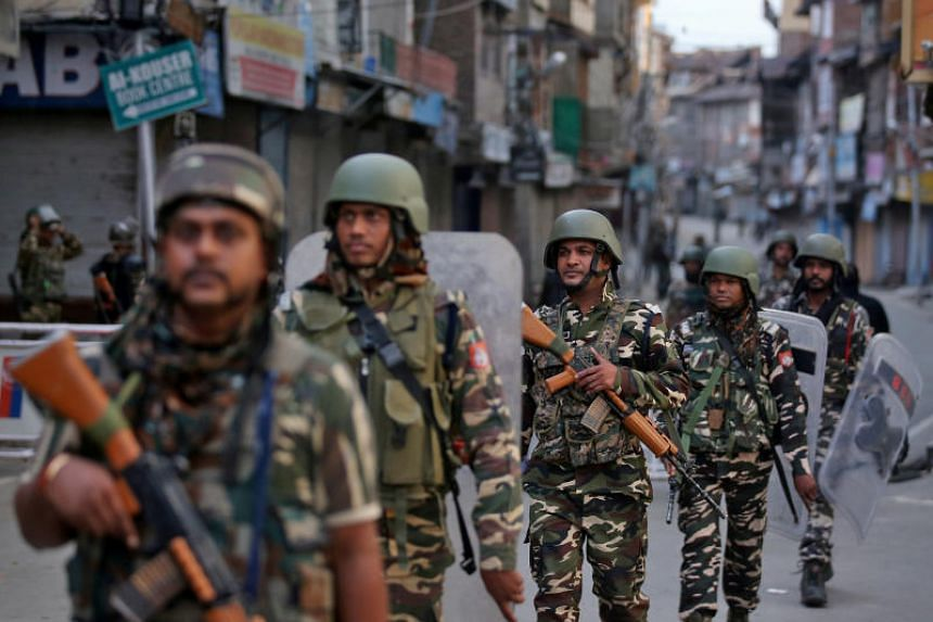 Indian security forces personnel patrolling a street in Srinagar, Kashmir, on Aug 9, 2019.