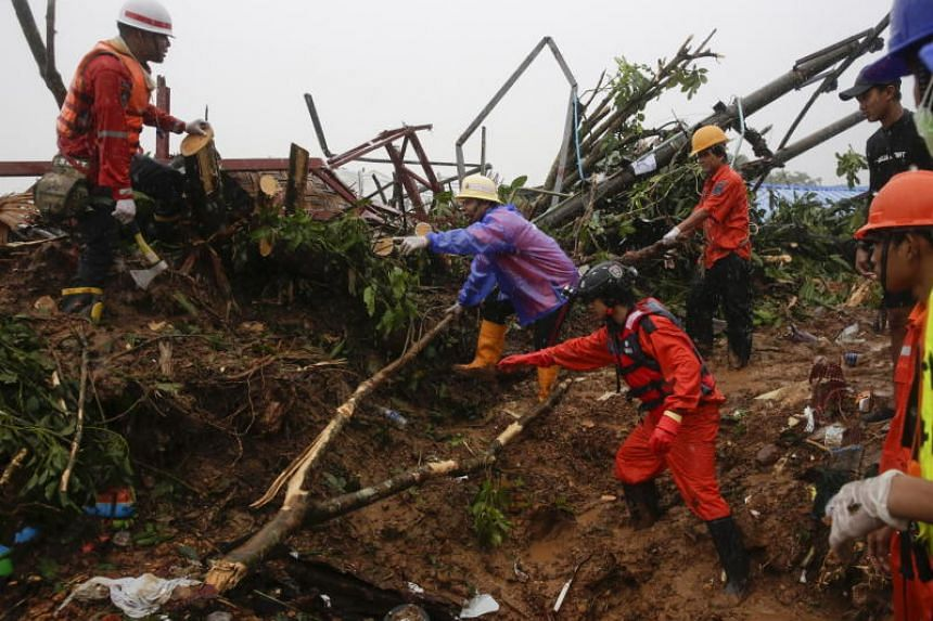 Rescuers looking for victims of a landslide near Mottama, Mon State, Myanmar, on Aug 10, 2019.
