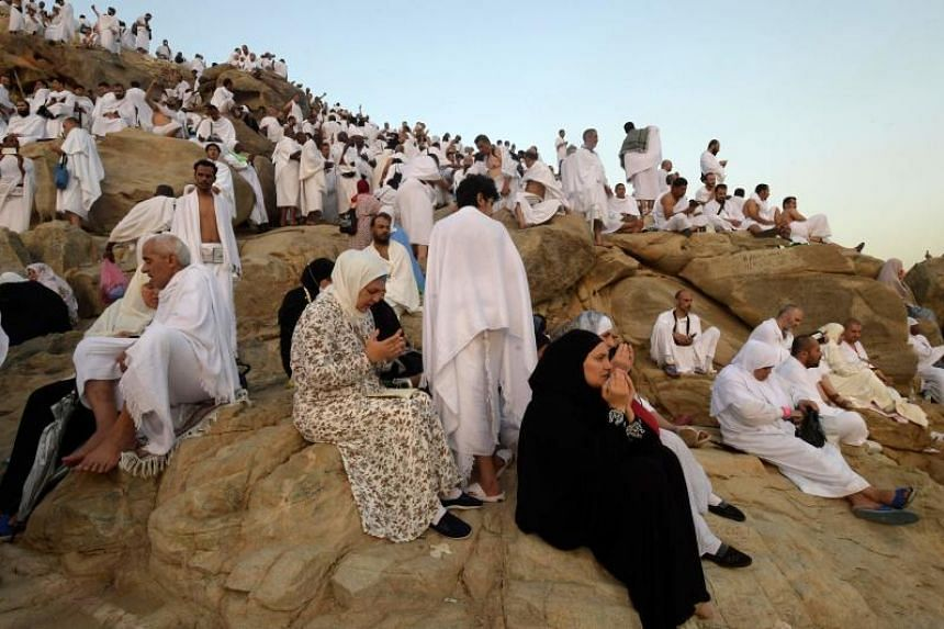 Muslim pilgrims praying on Mount Arafat in a vigil to atone for their sins and seek forgiveness as part of the annual haj pilgrimage.
