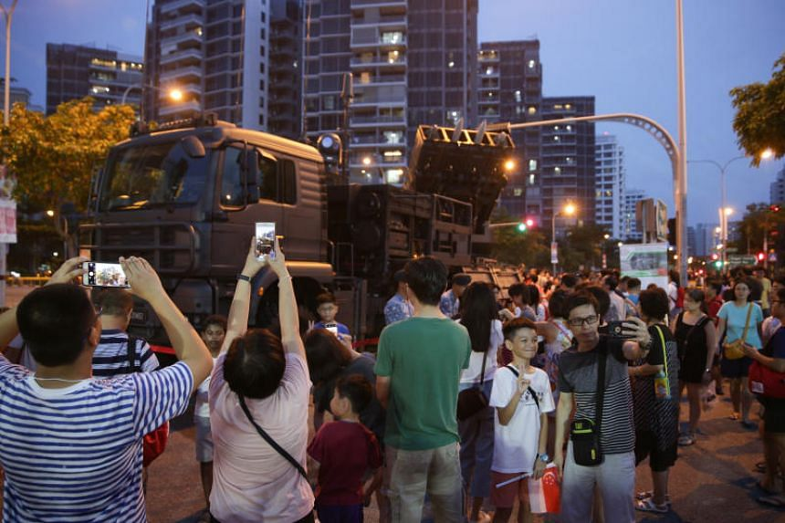 Residents taking photos of a SPYDER air-defence system in Punggol on Aug 10, 2019.