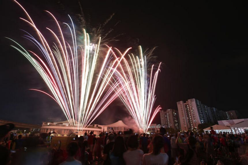 Fireworks are seen over Punggol during the National Day Heartlands Celebration on Aug 10, 2019.