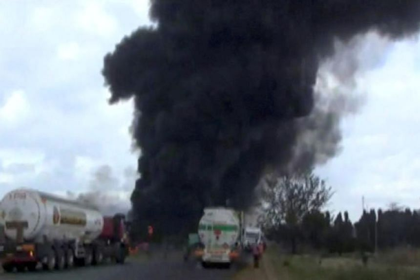 Smoke billowing into the air following the explosion of a fuel tanker in Morogoro, Tanzania, on Aug 10, 2019.