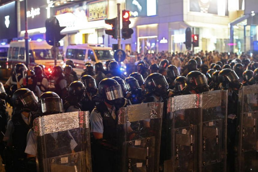 Riot police standing guard on Nathan Road to disperse anti-government protesters in Tsim Sha Tsui, on Aug 10, 2019.