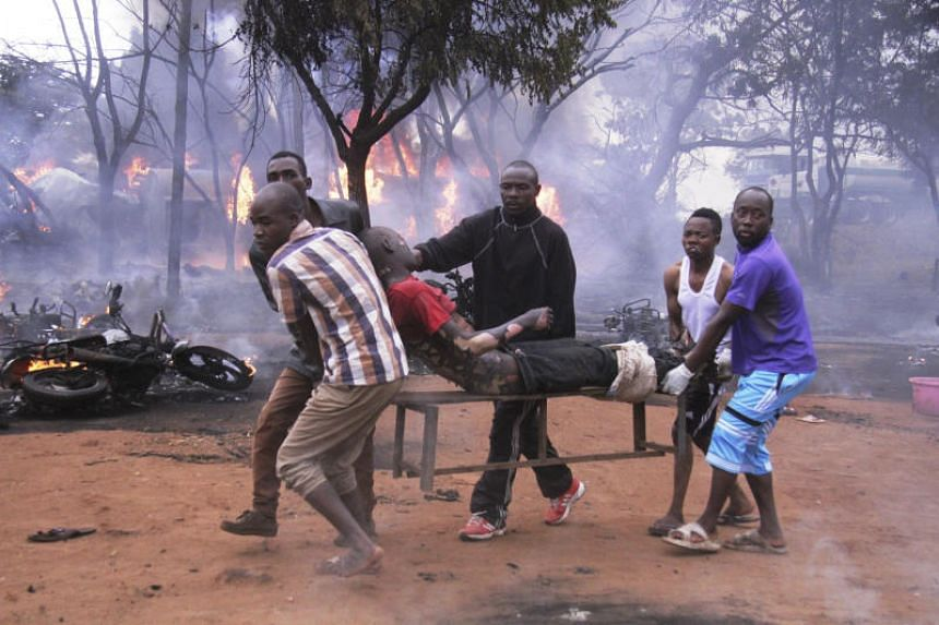 People carrying a man injured in the fuel tanker explosion in Morogoro, Tanzania, on Aug 10, 2019.