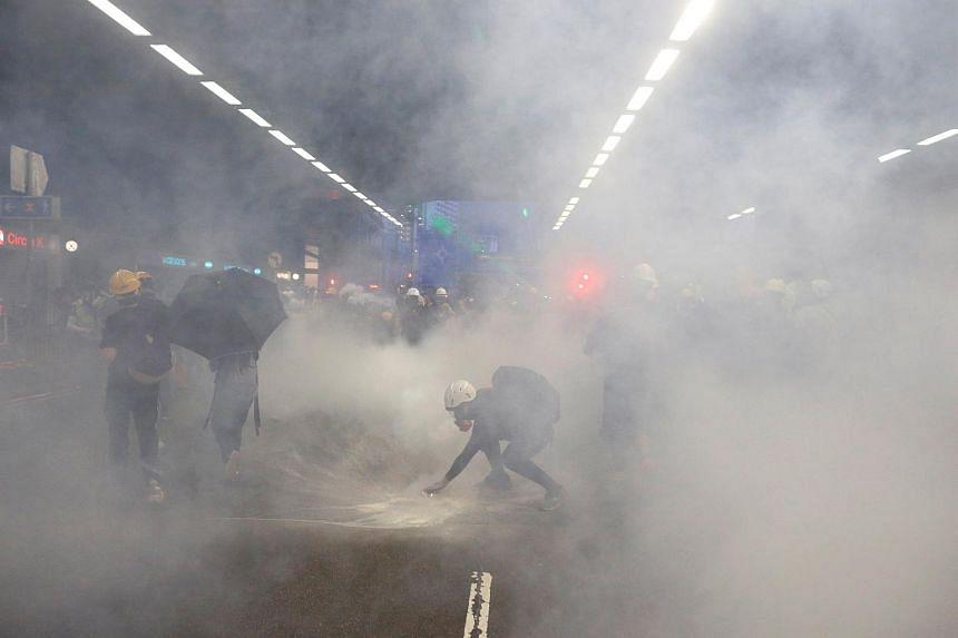 Protesters enveloped by tear gas during a confrontation with police at a demonstration in Tai Wai on Aug 10, 2019.
