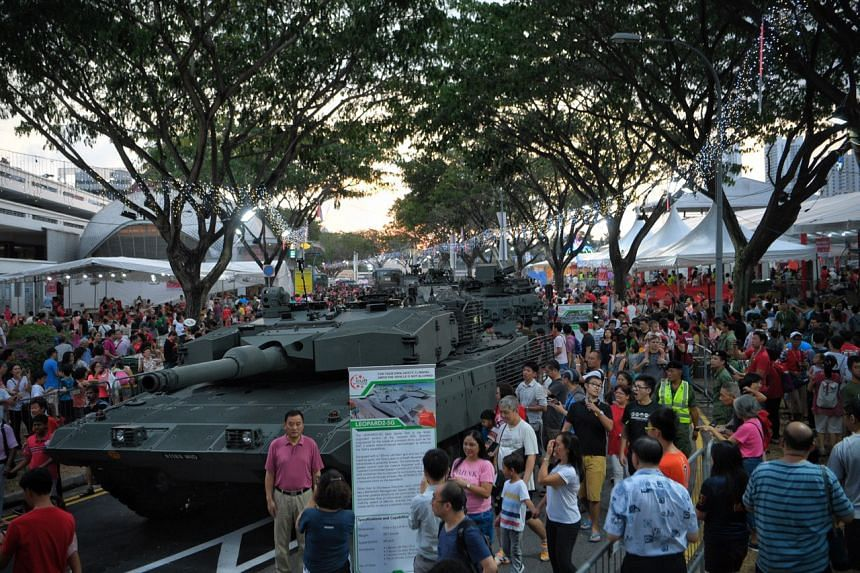 Members of the public getting a close-up view of an SAF Leopard 2SG main battle tank in Bishan, on Aug 10, 2019.