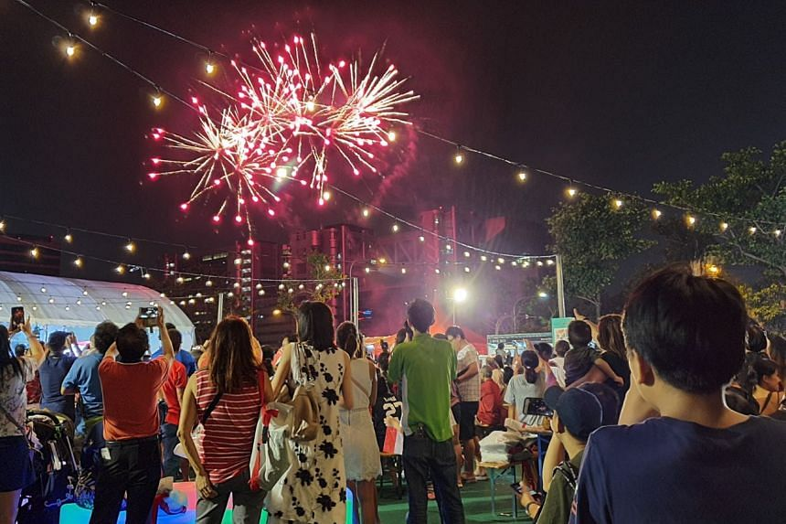 Members of the public watching fireworks at the Wisma Geylang Serai heartland celebrations, on Aug 10, 2019.