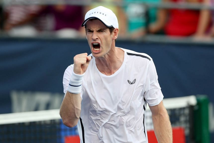 Andy Murray celebrates a shot while playing doubles with brother Jamie Murray during the Citi Open.