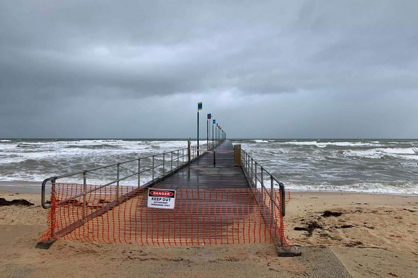 In Victoria state and Melbourne, winds reaching 120kmh brought down trees and damaged properties, with high tides at sea snapping off a pier.