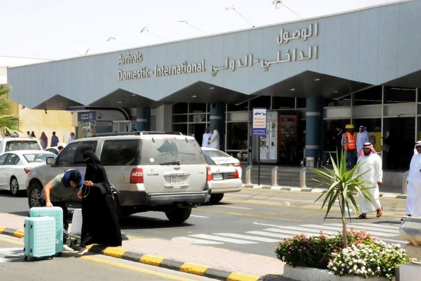 In a photo taken on June 2, 2019, travellers gather in front of the arrivals lounge at the Abha airport in Saudi Arabia.