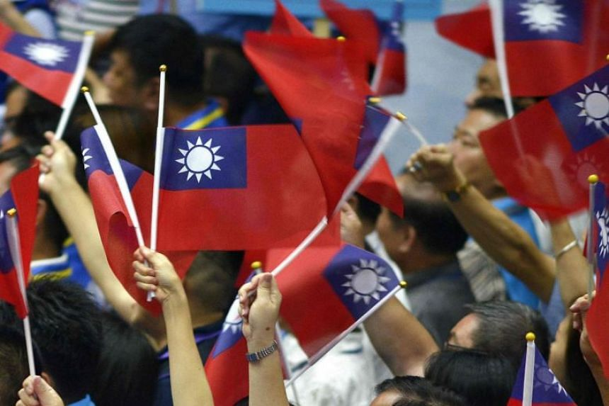 Attendees waving the Taiwanese flag during the Kuomintang national congress in Taipei, on July 28, 2019.