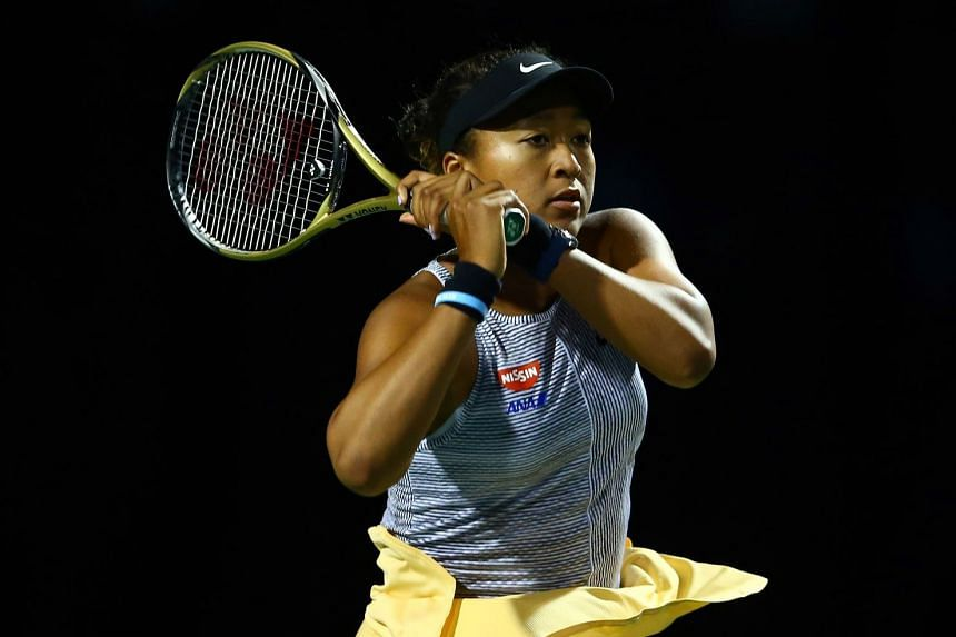 Osaka in action against Iga Swiatek of Poland during the third round of the Rogers Cup.