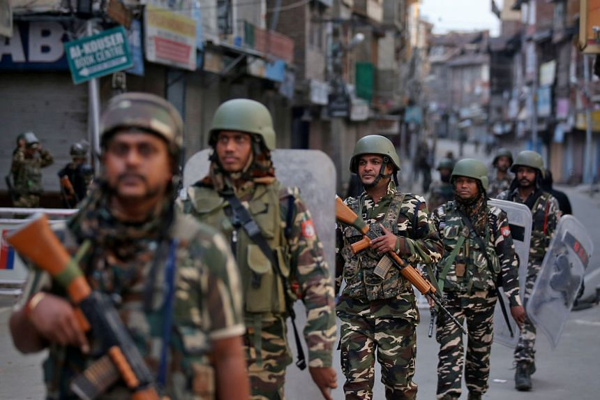 Indian security forces on patrol in Srinagar. Despite the huge security presence, sporadic protests have been reported in recent days in the city. PHOTO: REUTERS The Indian government's move to cancel the constitutionally guaranteed privileges of Kas