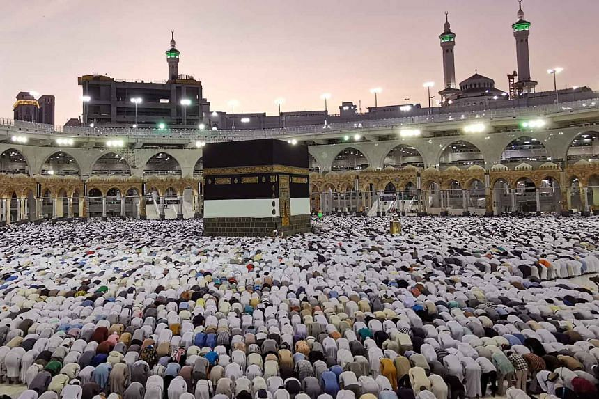 Muslims praying at the Grand Mosque during the annual Haj pilgrimage in Mecca, Saudi Arabia, on Thursday. The haj, one of the world's largest religious gatherings, is one of Islam's five pillars and must be undertaken by all Muslims with the means at