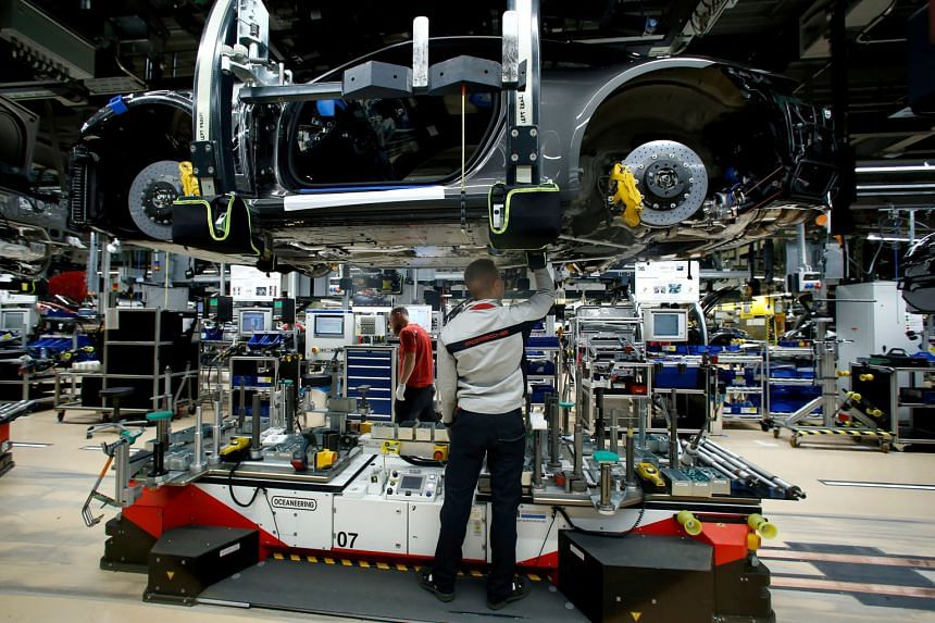 A sports car being assembled at a Porsche factory in Stuttgart-Zuffenhausen, Germany. The United States is the largest export market for the German car industry. Porsche, in particular, is dependent on the US market. It sells every fourth vehicle in