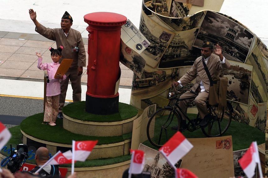 The Singapore Post bicentennial float featured decorations such as a colonial-era mailbox, postcards and a counter that was part of the old General Post Office.